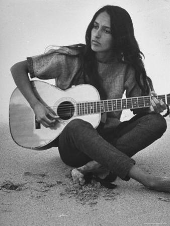 Folk Singer Joan Baez Strumming Her Guitar on the Beach Near Her Home by Ralph Crane