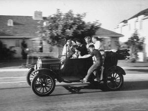 George Sutton and His Family Riding on a 1921 Model T Ford by Ralph Crane
