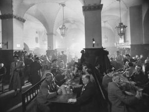 Interior of Munich Beer Hall, People Sitting at Long Tables, Toasting by Ralph Crane