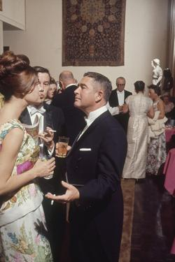 Museum Director Richard F. Brown Talking to Attendees of Los Angeles Museum of Art Opening by Ralph Crane