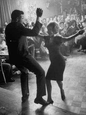 """Pop Singer Chubby Checker Singing His Hit Song """"The Twist"""" on Dance Floor at Crescendo Nightclub by Ralph Crane"""