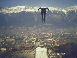 Skier Taking Off from the Bergisel Jump Hangs During Innsbruck Winter Olympics Competition by Ralph Crane