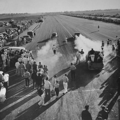 Spectators and Hot Rodders from the Nat. Hot Rod Assoc. at Drag Race on Quarter Mile Strip by Ralph Crane