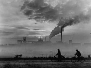Steel Mill in Dusseldorf, German Steel Workers Bicycling Home from Work by Ralph Crane
