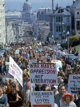 Students Carrying Antiwar Signs While Marching in Protest of US Involvement in the Vietnam War by Ralph Crane