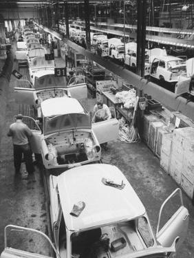 View of an Auto Plant and Workers by Ralph Crane