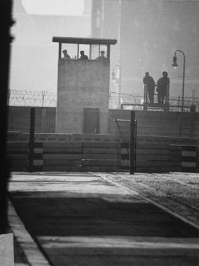 West Berliners Standing on a Sightseeing Platform on the West Side of the Wall by Ralph Crane