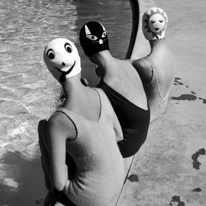 Women Modeling Bathing Caps with Faces on Them by Ralph Crane