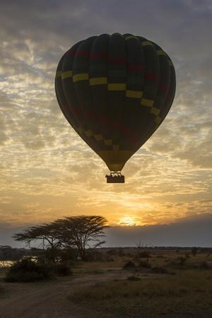 Africa. Tanzania. Hot air balloon crossing the Mara River, Serengeti National Park.