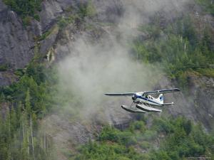 Float Plane against Granite Cliff, Alaska by Ralph Lee Hopkins
