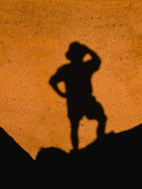 Hiker's Shadow Cast on a Rock, Red Mountain Geologic Area, Coconino National Forest, Arizona by Ralph Lee Hopkins