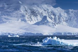 Icebergs and Mountains Near Cuverville Island, Antarctica by Ralph Lee Hopkins