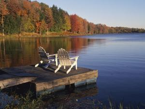 Adirondack Chairs on Dock at Lake by Ralph Morsch