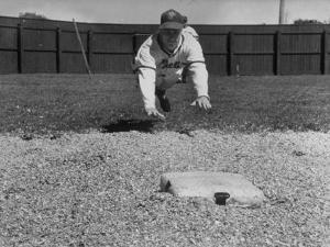 Baseball Player Richie Ashburn Making a Belly-Whopper Slide into Base During Practice by Ralph Morse