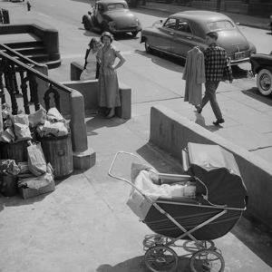 Brooklyn Street Scene, Baby Carriage, Two Women, and a Boy Carrying Dry Cleaning, NY, 1949 by Ralph Morse