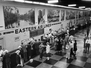 Eastern Airline Customers Checking in their Baggage at the Check-In Counter by Ralph Morse