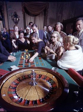 February 11, 1957: Tourists Gambling at the Nacional Hotel in Havana, Cuba by Ralph Morse