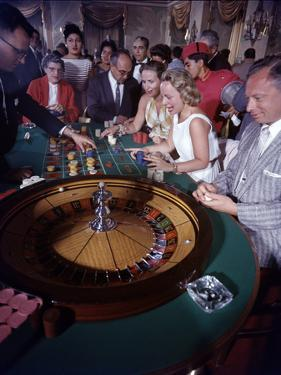 February 11, 1957: Tourists Gambling at the Nacional Hotel in Havana, Cuba by Ralph Morse