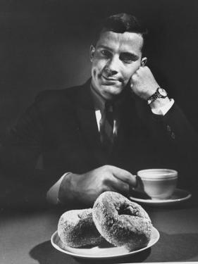 Local Man with Donuts and Coffee by Ralph Morse