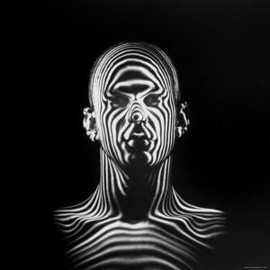 Man with Patterns of Light Covering Face and Shoulders in Air Force Study in Making Flight Helmets by Ralph Morse