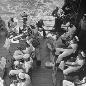 Members of Ship's Band Aboard US Navy Cruiser Playing on Deck, Daily Musical Practice During WWII by Ralph Morse