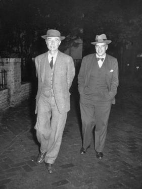 Physicist J. Robert Oppenheimer Walking with His Lawyer Lloyd K. Garrison by Ralph Morse