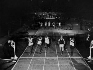 Triple Exposure of Start, Mid and Finish of 60 Yard Dash at Millrose Games by Ralph Morse