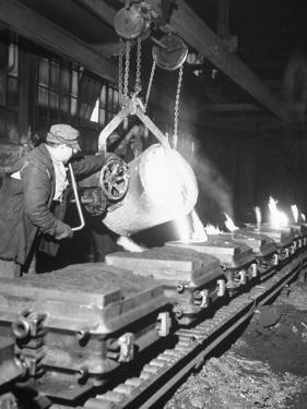 Worker Pouring Hot Steel into Molds at Auto Manufacturing Plant by Ralph Morse
