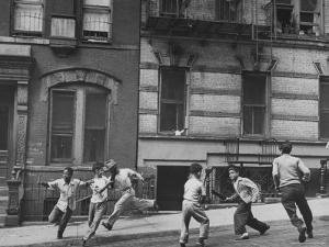 Young Boys with Sticks, Running Around While Playing a Street Game in Spanish Harlem by Ralph Morse