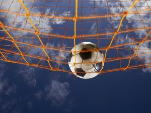 Soccer Ball Going Into Goal Net by Randy Faris