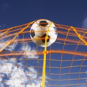 Soccer Ball Going Into Goal Net by Randy Faris