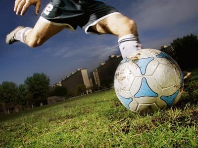 Soccer Player Kicking Ball by Randy Faris
