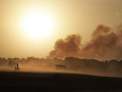 A Dust Cloud Envelops the Kara Village of Dus by Randy Olson