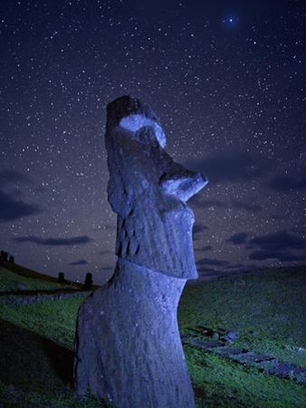 An Ancient Moai Statue on a Hillside at Night by Randy Olson