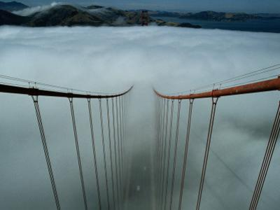 Cables of the Golden Gate Bridge Above the Early Morning Fog by Randy Olson