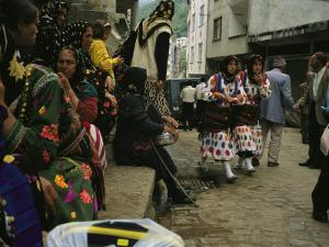Cepni Women in Traditional Garb Gather on a Turkish Street by Randy Olson