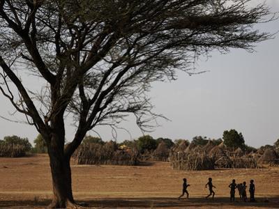 Kara Children Playing Games in their Village by Randy Olson