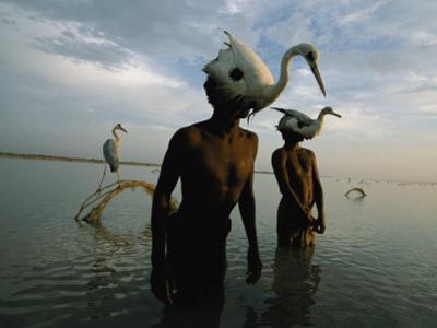 Mohanis Fishermen Catch Herons in the Indus River by Randy Olson