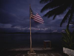 The American National Flag Sways in the Breeze at Twilight by Randy Olson