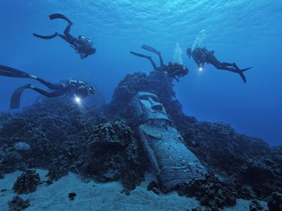 Tourists Diving on Easter Island's Reef Encounter a Fake Moai by Randy Olson