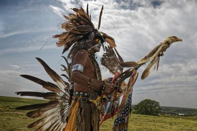 Traditional dress at a Powwow. by Randy Olson
