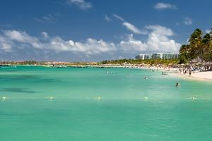 Vacationers along Palm Beach in Aruba by raphoto