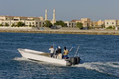 https://imgc.allpostersimages.com/img/posters/ras-al-khaimah-fishing-boat-leaves-harbour_u-L-Q1AS8ID0.jpg?artPerspective=n