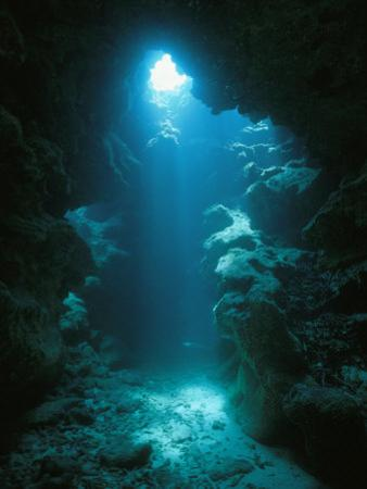 A Beam of Sunlight Illuminates an Underwater Cave by Raul Touzon