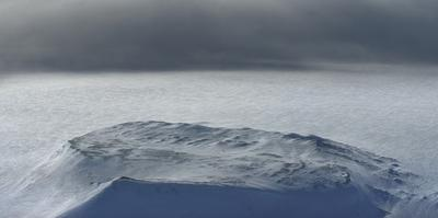 A storm over Hofsjokull glacier. by Raul Touzon