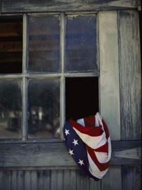 An American Flag Lies Loosely Bunched in an Open Window by Raul Touzon
