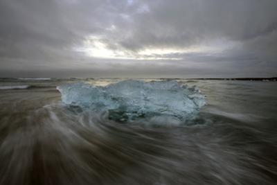 Black Sand Beach with Ice and Small Icebergs by Raul Touzon