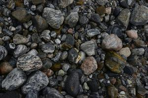 Close-Up of Beach Pebbles by Raul Touzon