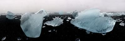 Close Up of Icebergs on Black Sand Beach in Iceland by Raul Touzon