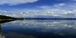 Clouds Reflected in Yellowstone Lake by Raul Touzon